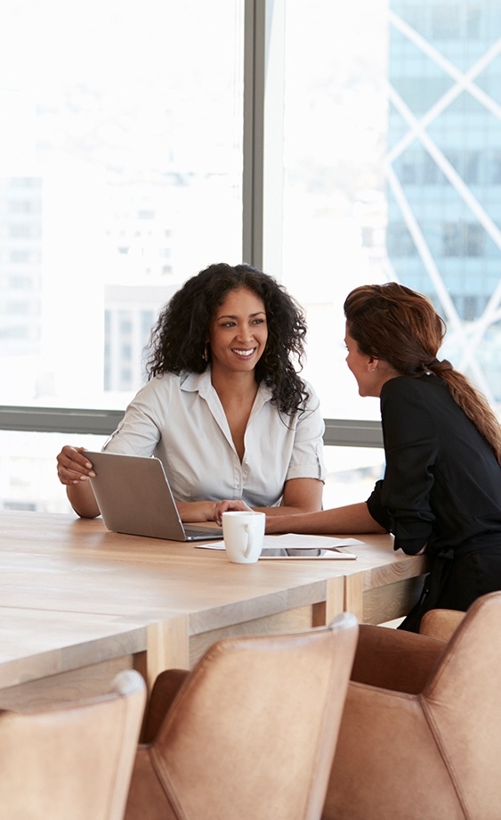 women collaborating using mobile technology