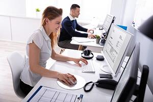 Two employees processing invoices resized