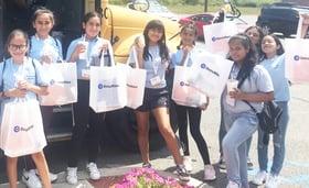 Girls holding Docuware bags