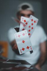 Magician and playing cards