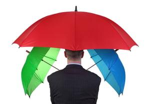 Man holding umbrellas