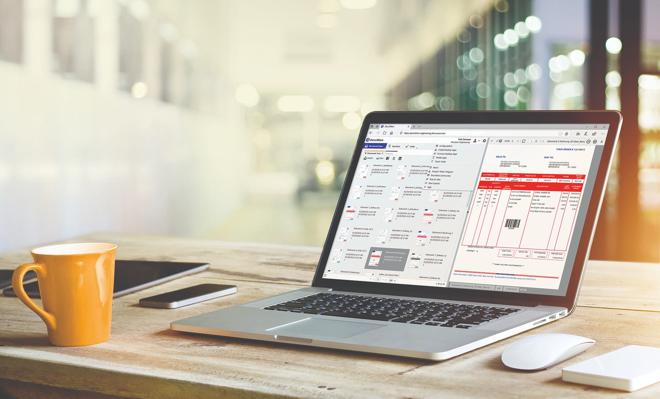 Laptop with DocuWare ECM invoice management dashboard