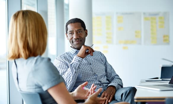 Manager and employee having a conversation   paperless employee management solutions