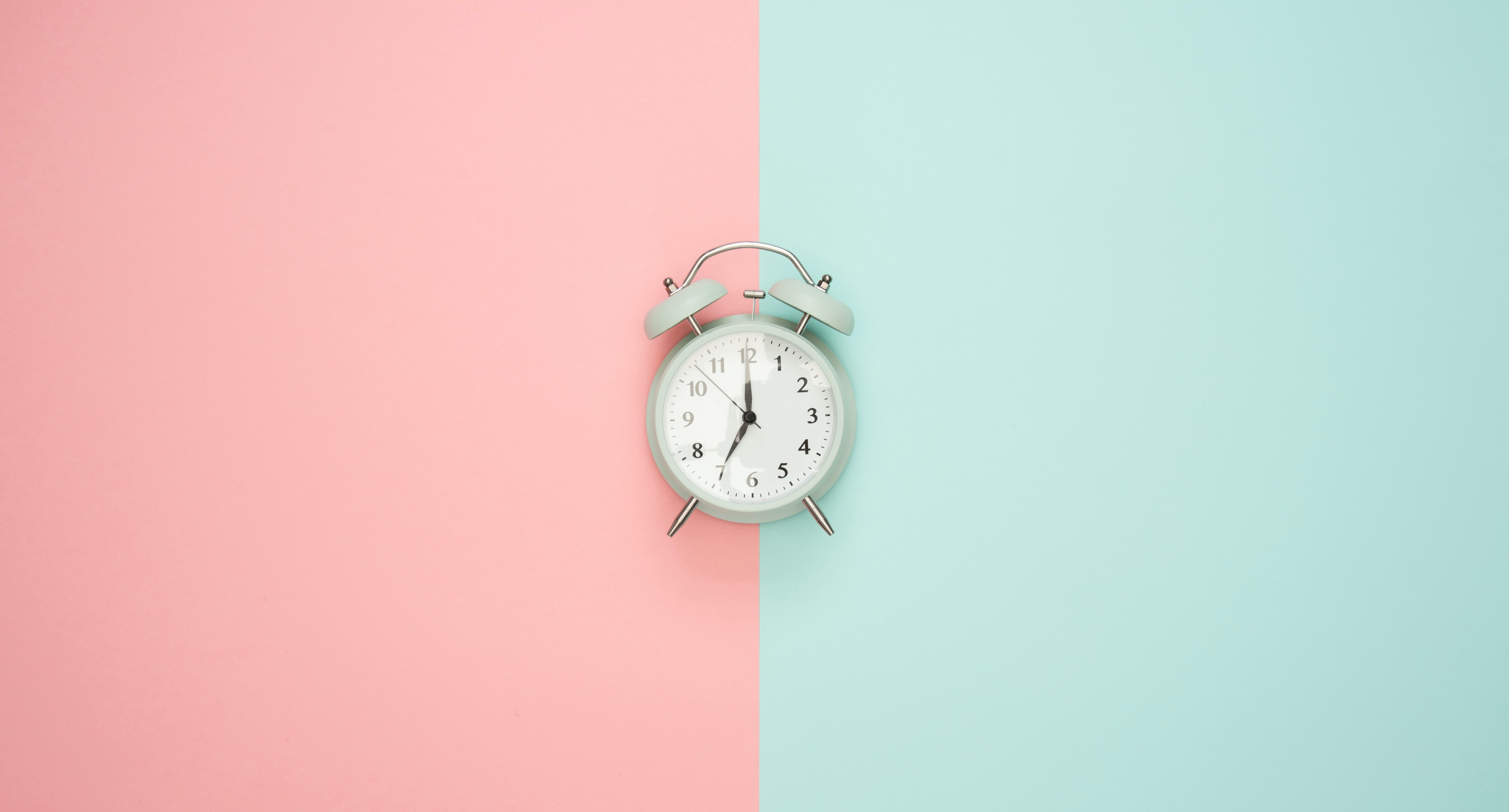 Clock on pink and green background
