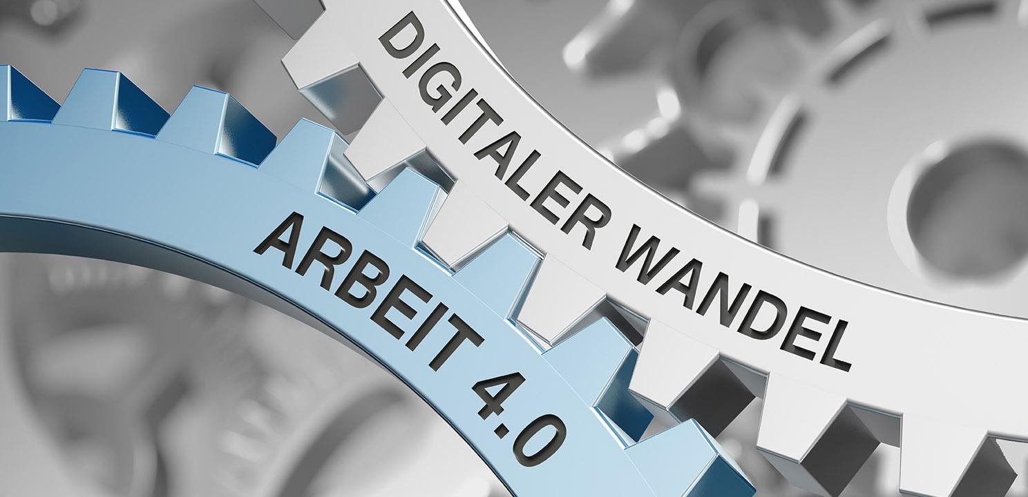 Zwei Zahnräder mit der Aufschrift Arbeit 4.0 und Digitaler Wandel greifen ineinander