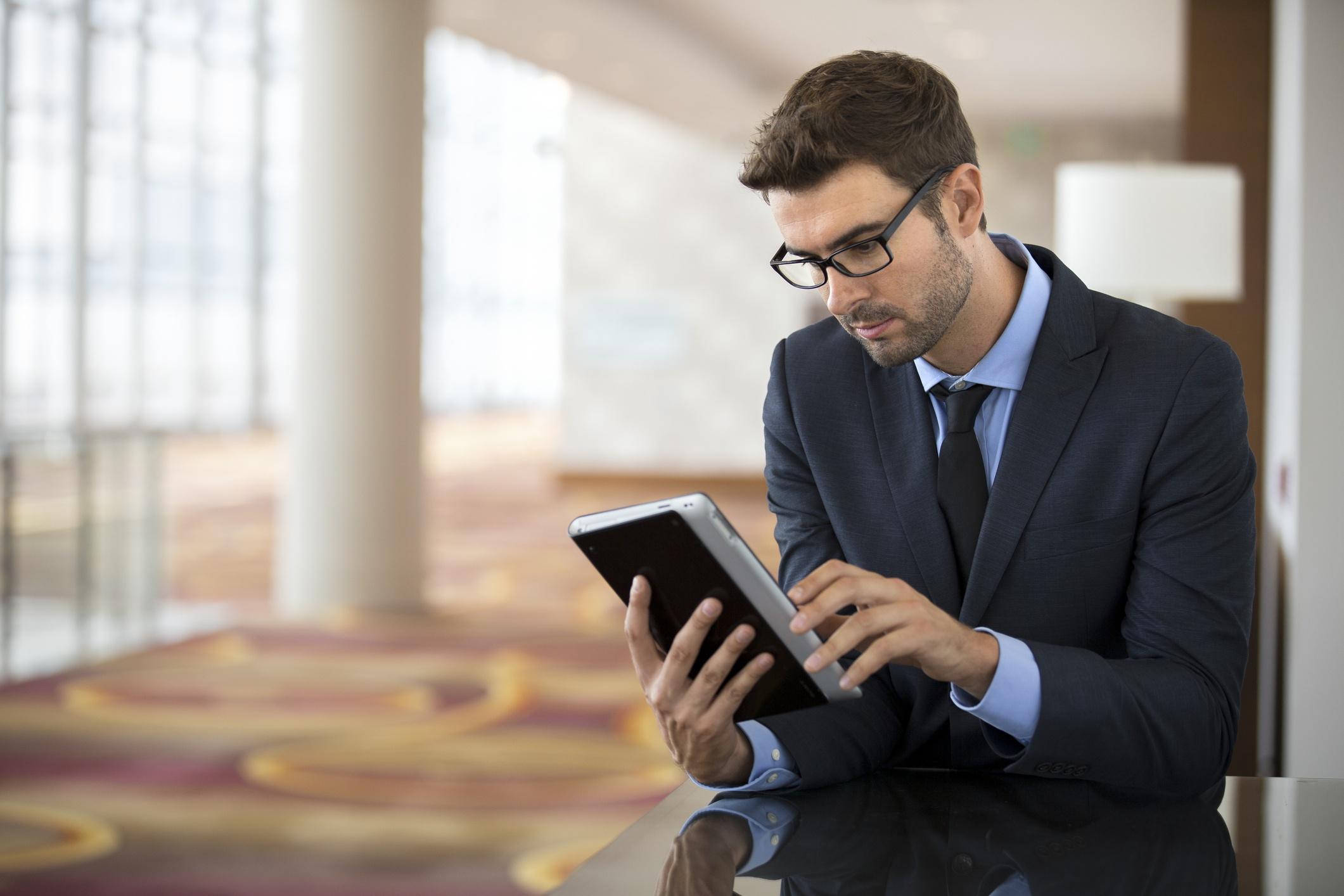 Focused Businessman Using a Tablet