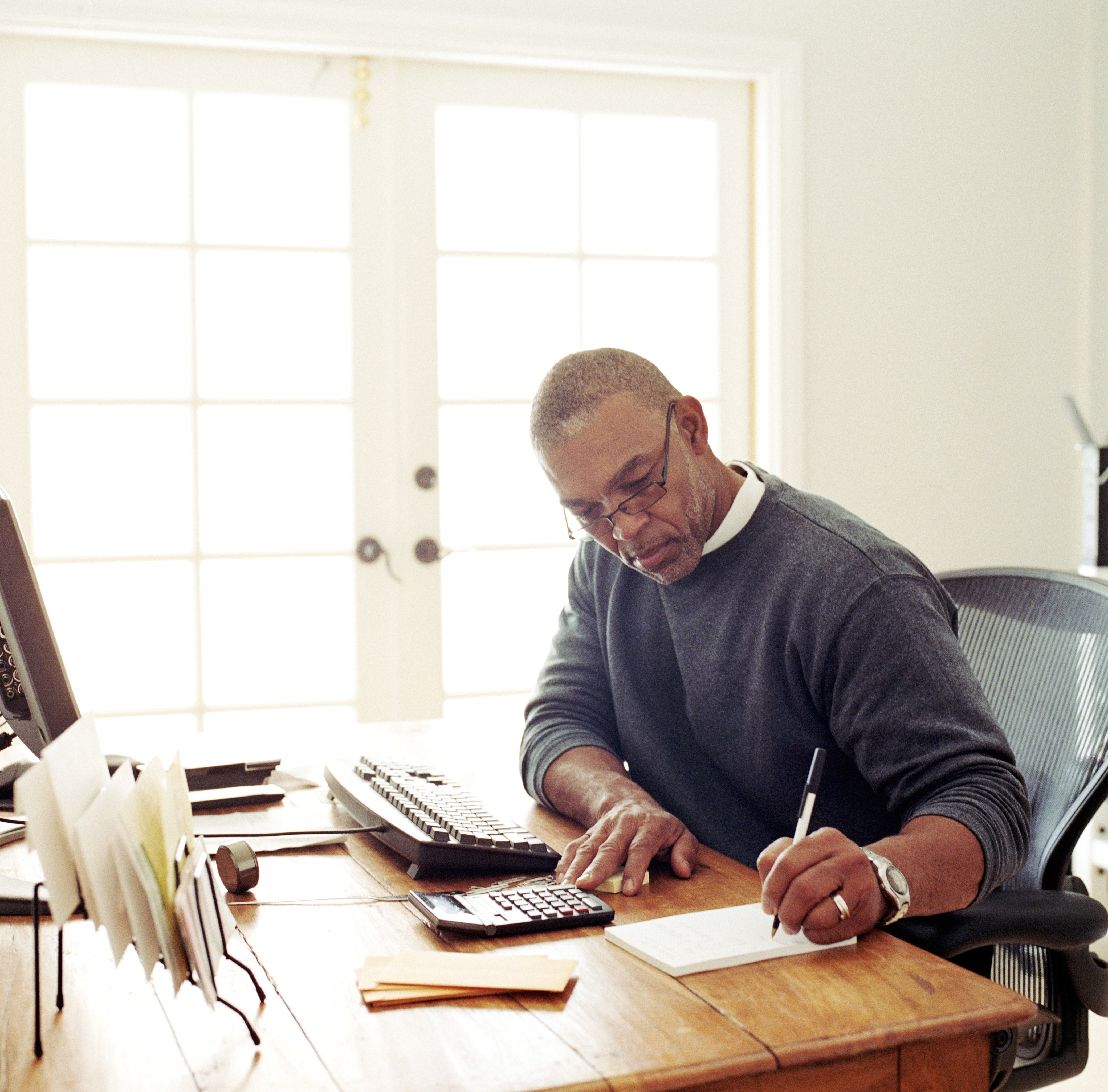 Mature Man Working Remotely at Home