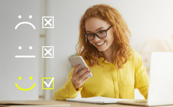 Woman at computer in yellow shirt