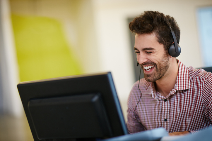 Employee at computer happy because of email automation